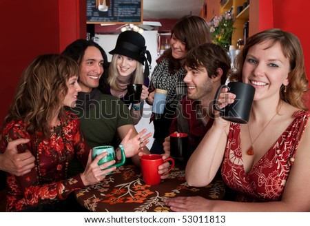 Group of six friends engaged in a social activity