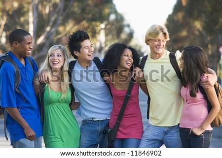Group of six friends having fun outside