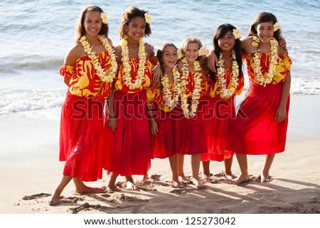 Group of six polynesian Hula girls  in Friendship looking at camera