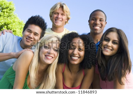 Group of six young friends having fun outside