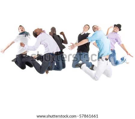 Group of six young stylish teenagers jumping in joy over white background.