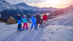 Group of skiers children watch the scene