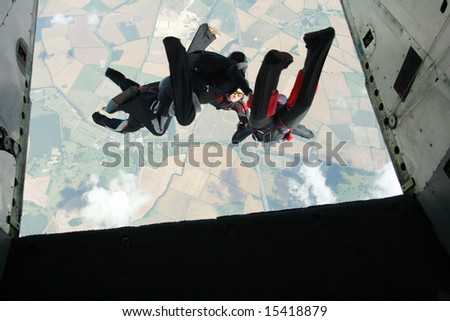 Group of skydivers exit an airplane