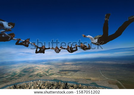 Group of skydiving executives forming a circle in mid-air