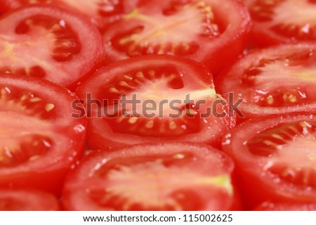 Group of sliced tomatoes forming a background
