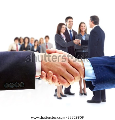 Group of smiling business people. Handshake.