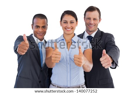 Group of smiling business people showing their thumbs up on white background