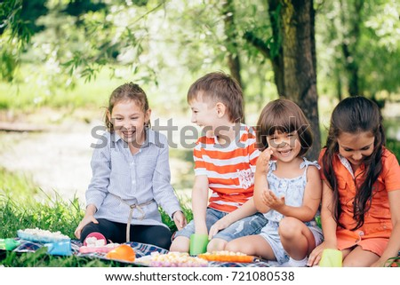 Group Of Smiling Children Relaxing In Park #721080538