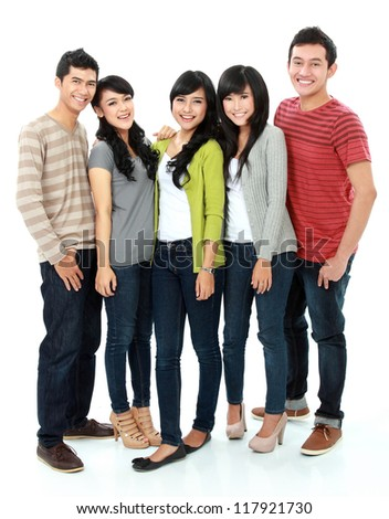 group of smiling friends  looking at camera and embracing