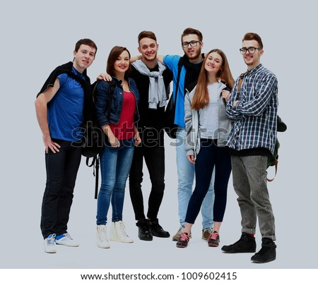 group of smiling friends staying together and looking at camera isolated on white background.