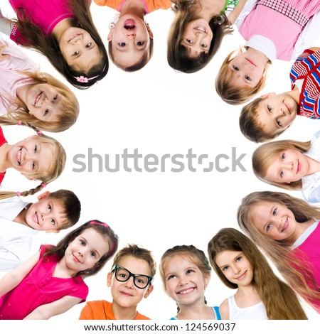 Group of smiling kids standing in huddle on white background