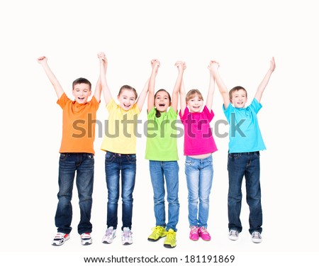 Group of smiling kids with raised hands in colorful t-shirts standing together - isolated on white.