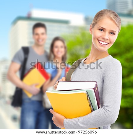 Group of smiling  students and girl with book. University education.