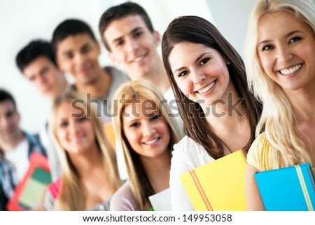 Group of smiling students posing.
