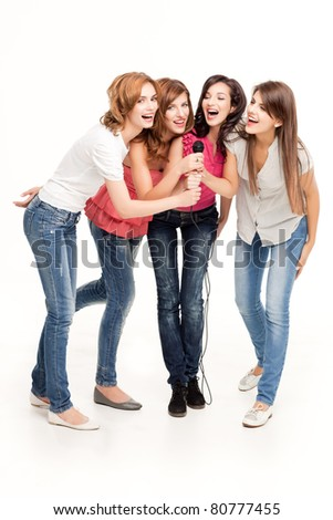 group of smiling women having fun singing