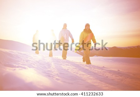 Group of snowboarders on top of the mountain. #411232633