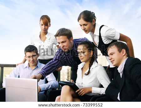 Group of some business people working in the open air office