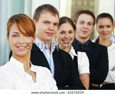 Group of some business people working in the open air office (WARNING! Focus only on the red head's face)