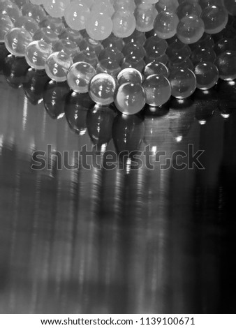 group of spheres and reflections in a bowl, abstract background black and white #1139100671