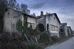 Group of spooky abandoned houses at dusk