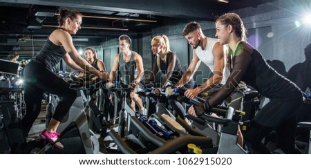 Group of sporty people on cycling class