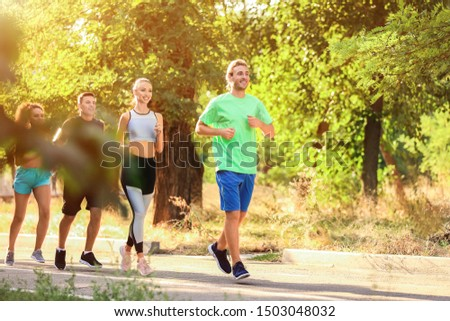 Group of sporty young people running outdoors #1503048032