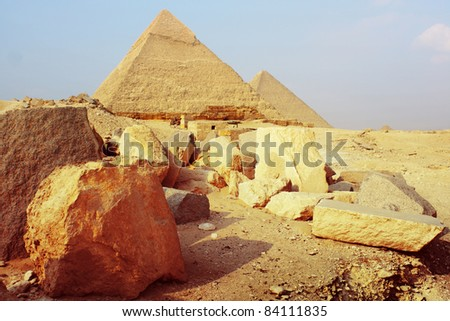Group of stones and pyramids (Cheops and Chefren) on the background