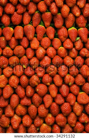 Group of strawberries at public market in Barcelona, Spain.
