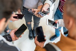 group of student holding smartphone in hands, many cellphone and people having addiction on social network and app, millennial generation behavior of social segregation