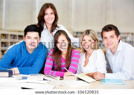 Group of students at the library looking happy