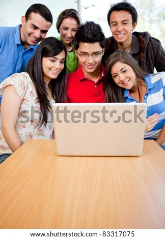 Group of students at the university with a computer