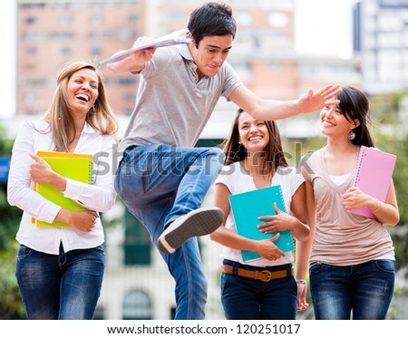 Group of students having fun looking at a man jumping