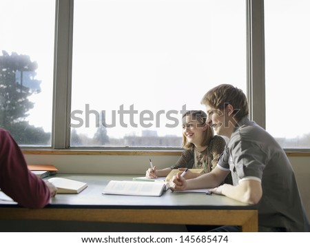 Group of students in the reading room - stock photo