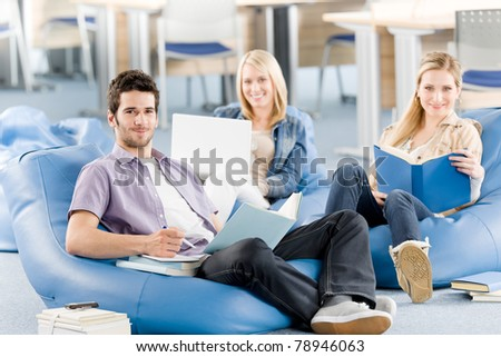 Group of students learning at high school relaxing with books