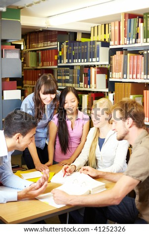 Group of students learning in library at university