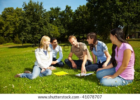 Group of students learning on campus of university