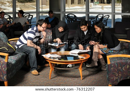 Group of students of diverse ethnic background studying together