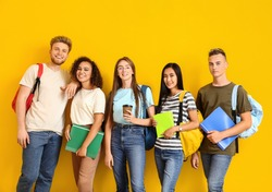 Group of students on color background