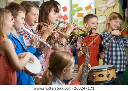 Group Of Students Playing In School Orchestra Together #268247171