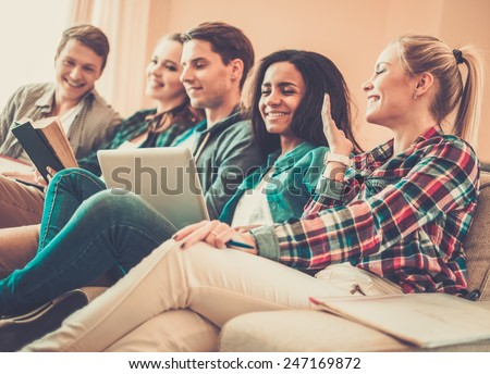 Group of students preparing for exams in apartment interior  #247169872