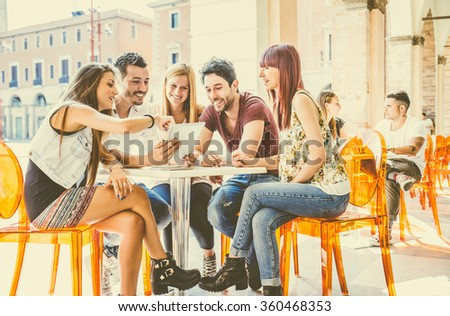 group of students sitting in a...