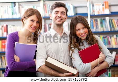 Group of students standing in a library