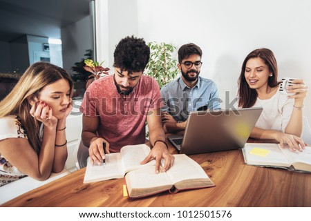 Group of students study at home. Learning and preparing for university exam.