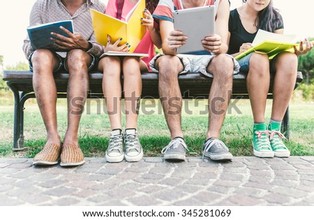 Group of students studying outdoor. Concept about education, people and friendship