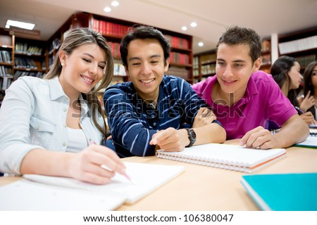 Group of students studying together at the library