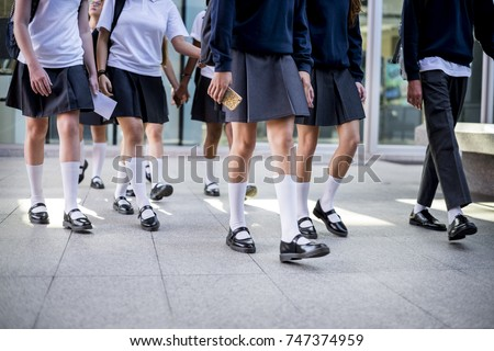 Group of students walking at school