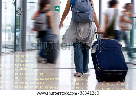 Group of Students Walking in the Airport Terminal - stock photo