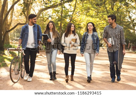 Group of students walking together in the park