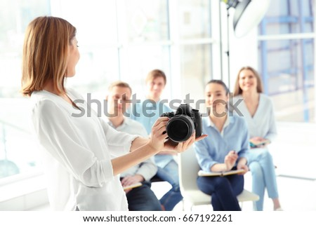 Group of students with instructor during photography classes