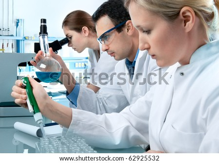 group of students working at the laboratory - stock photo